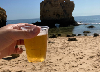 A cup of beer on the beach